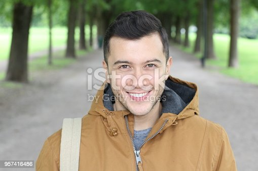 972902010istockphoto Trendy male with a winter outfit smiling 957416486