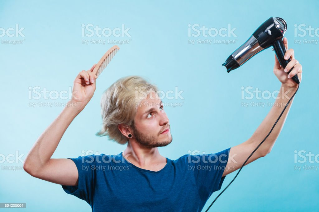 Trendy man with hair dryer royalty-free stock photo