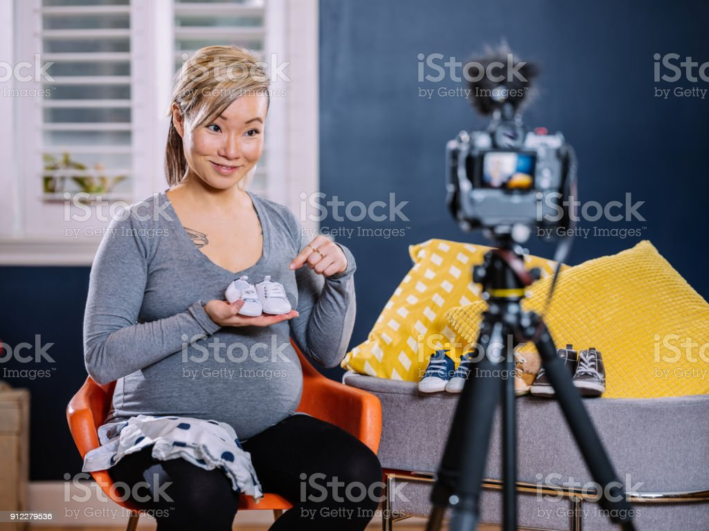 Trendy new mommy Vlogger stock photo