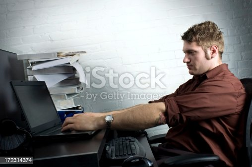 947303582 istock photo Trendy Office Worker at Workstation 172314374