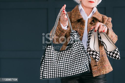 istock trendy senior wardrobe female style elegance 1133957104