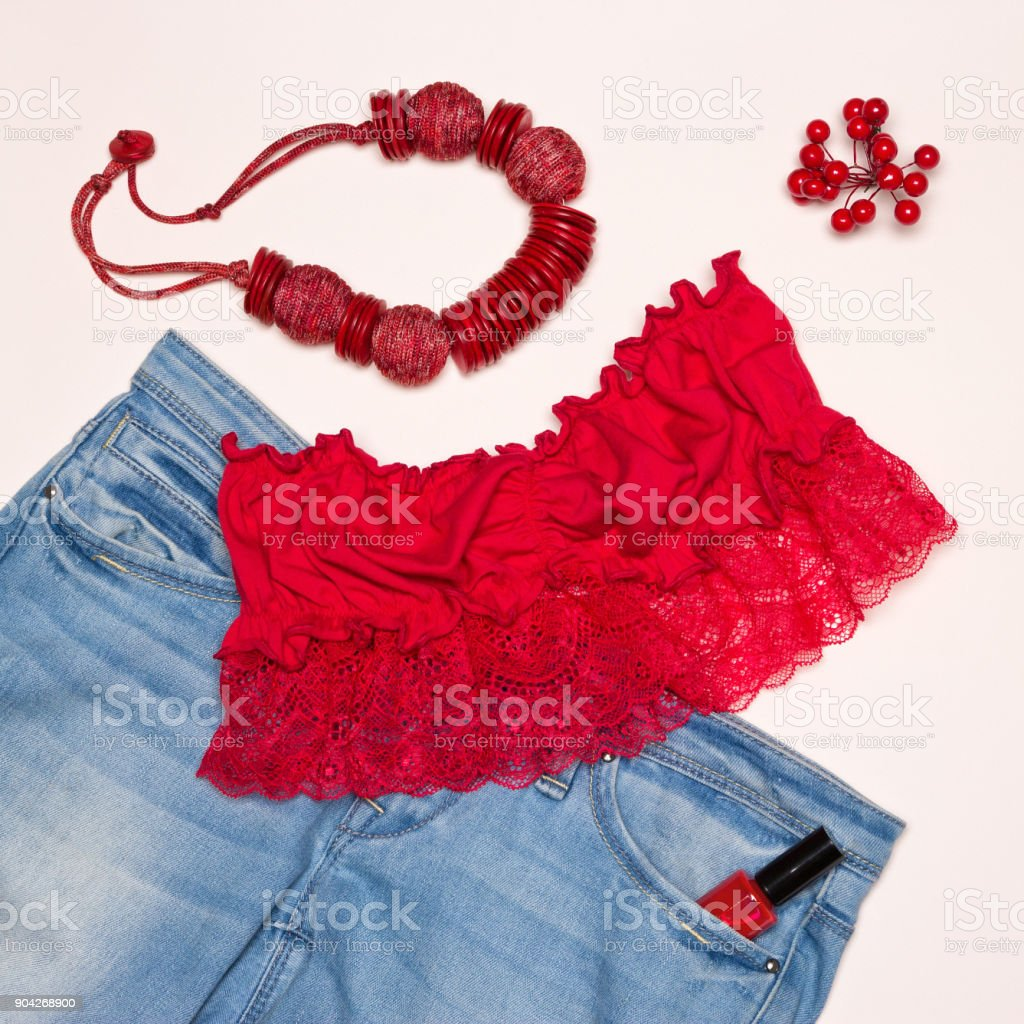 Trendy summer women outfit with red accents stock photo