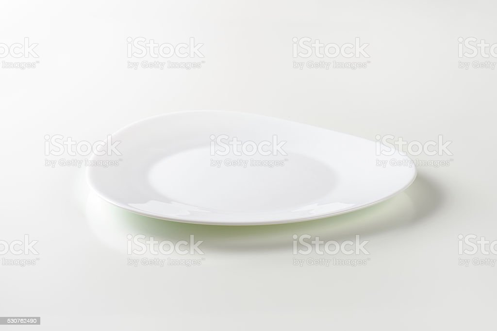 Trendy triangle white plate stock photo