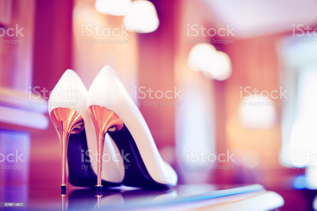 Trendy ultraviolet toned picture of bridal stiletto heel shoes stock photo