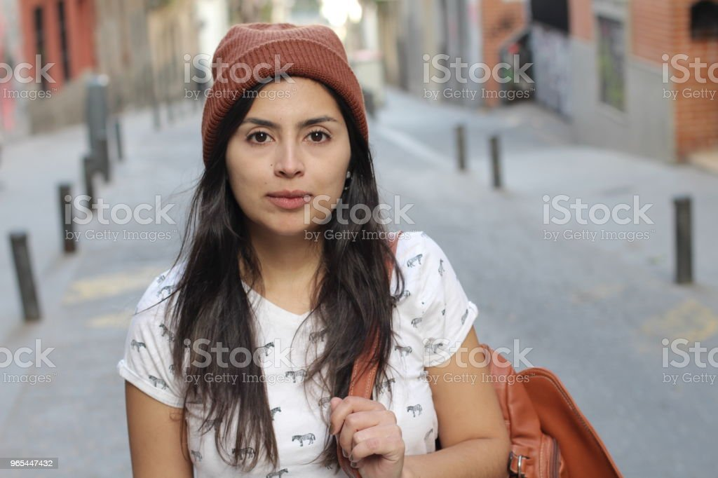 Trendy urban latin woman with copy space royalty-free stock photo