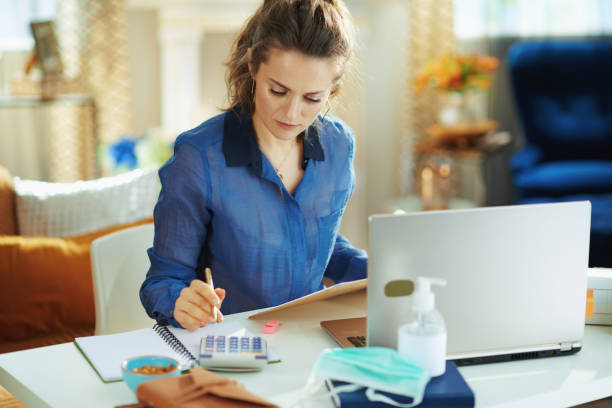 trendy woman at modern home in sunny day working stock photo