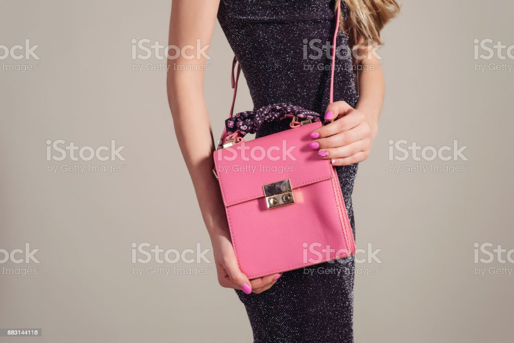 trendy woman in Evening Dress with pink bag in hands stock photo