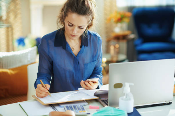 trendy woman in modern house in sunny day working stock photo