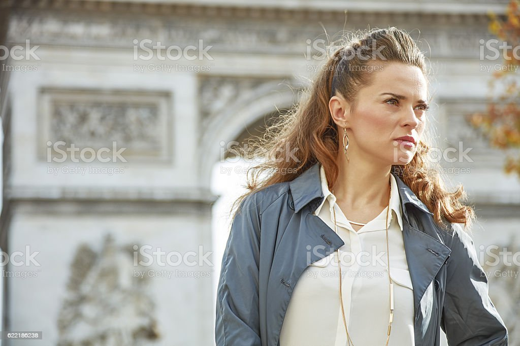 Stylish autumn in Paris. trendy woman in trench coat in Paris, France...