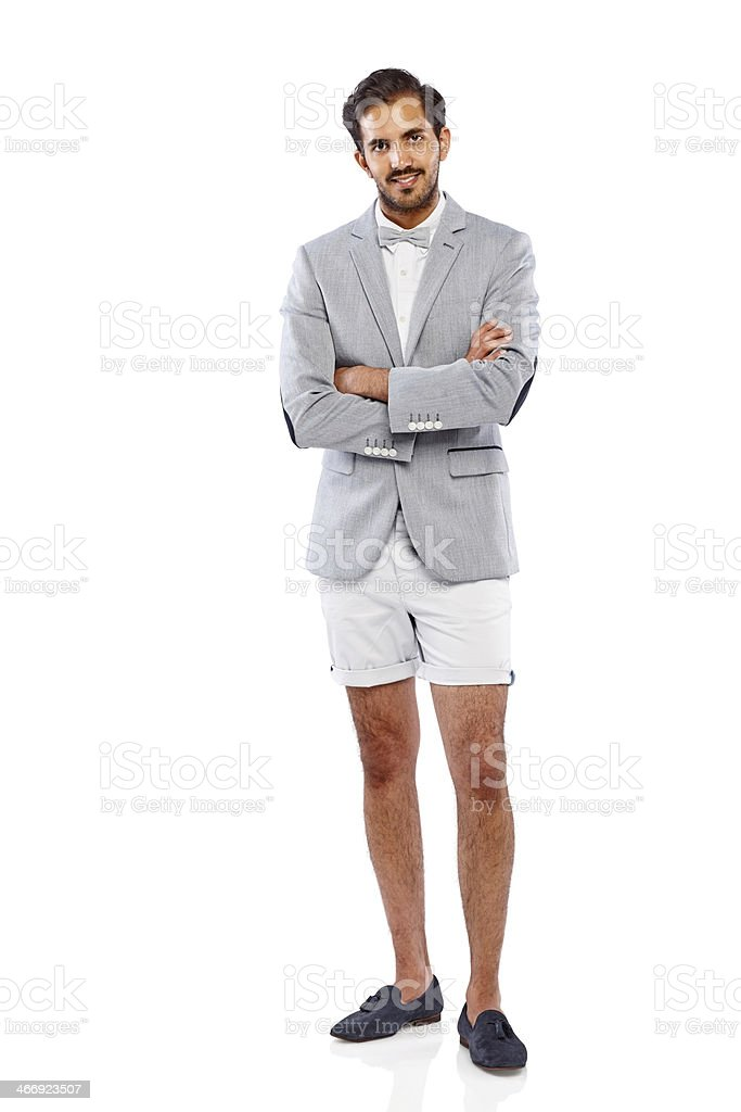Trendy young businessman standing confidently stock photo