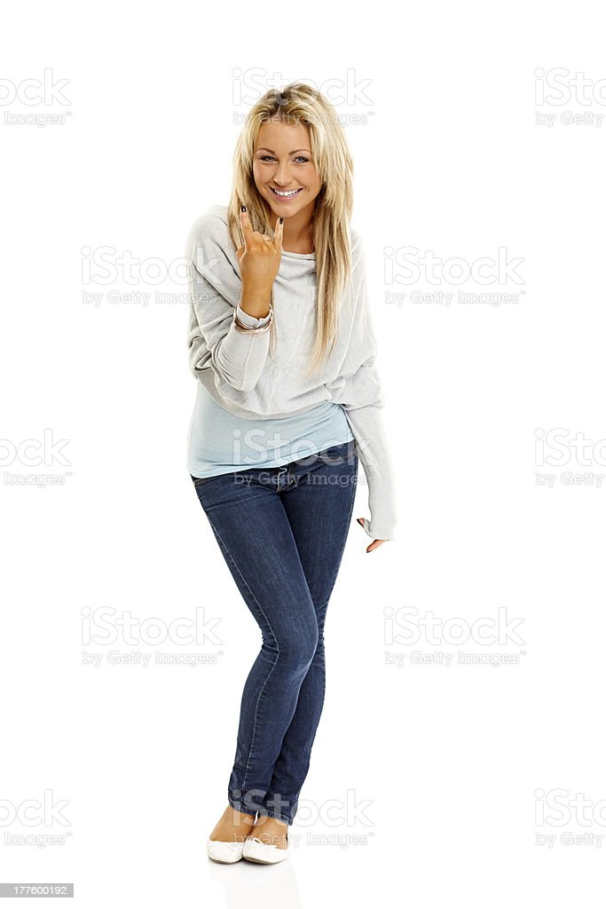 Trendy young female gesturing rock and roll sign royalty-free stock photo