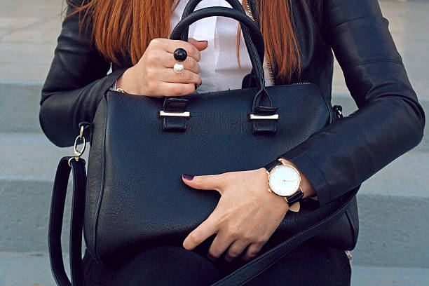 trendy young girl holding big black handbag street - leder handtaschen damen stock-fotos und bilder