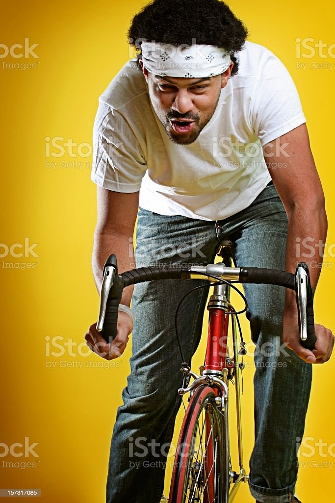 Trendy Young Man On Street Bike Making Funny Face royalty-free stock photo