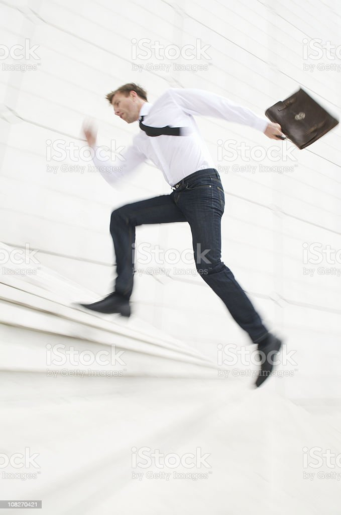 Trendy Young Man Sprinting Up Steps royalty-free stock photo