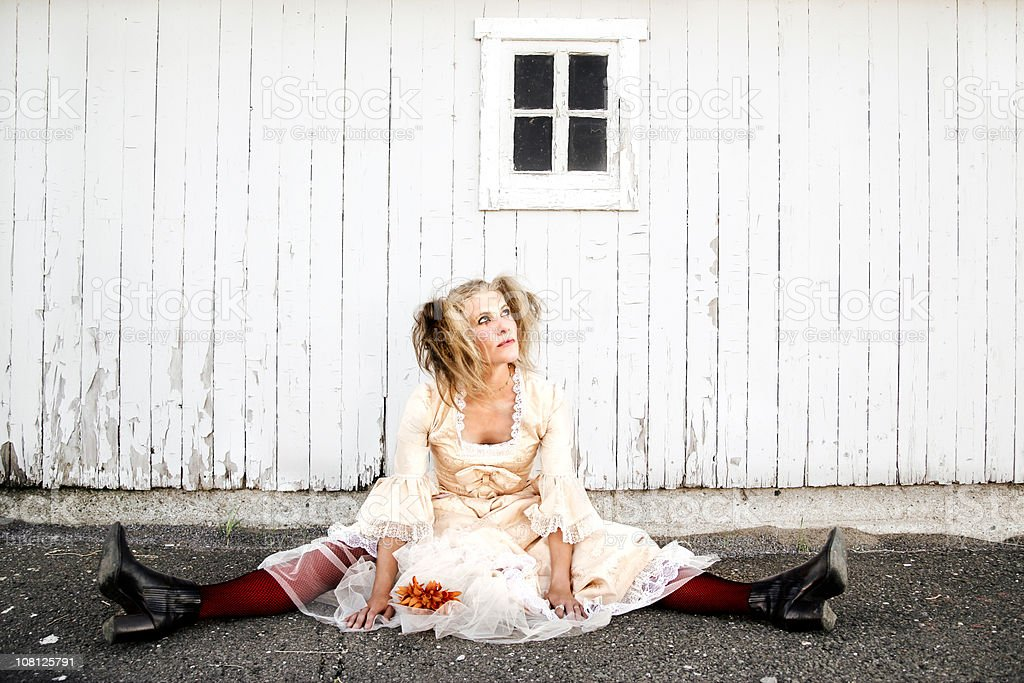 Trendy Young Woman Sitting on Ground royalty-free stock photo