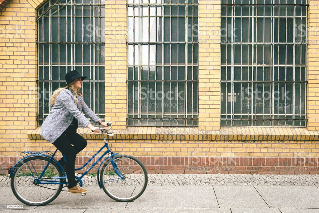 Trendy Young Woman With Her Bike, Urban Landscape On Background stock photo