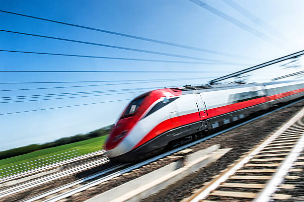 Treno ad alta velocità Reggio Emilia, Italy - September 6, 2015: High-speed rail in Italy consists of two lines connecting most of the country's major cities. The first line connects Turin to Salerno via Milan, Bologna, Florence, Rome and Naples, the second runs from Turin to Venice via Milan, and is under construction in parts. electric train stock pictures, royalty-free photos & images