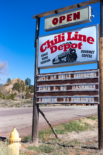 Tres Piedras, NM: A weathered roadside restaurant sign in Tres Piedras, a village in northern New Mexico near Taos.