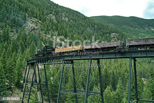 Georgetown, Colorado, USA - June 23, 2013: A substructure of bridge piling and braces on concrete abutments, supports the trestle bridge superstructure for the engine and passenger cars in Georgetown, Colorado