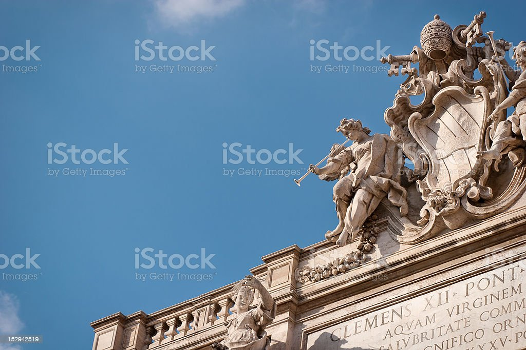 Trevi Fountain and Poli Palace Roof Statues in Rome stock photo