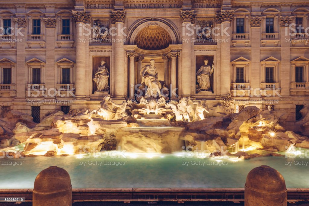 Trevi fountain at sunrise, Rome, Italy. Rome baroque architecture and...