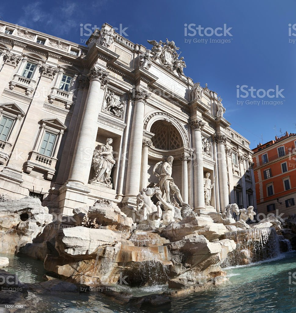 Trevi Fountain in downtown Rome, with pool and blue sky stock photo