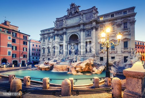 Trevi Fountain in Rome, Italy at sunrise. Scenic travel background.