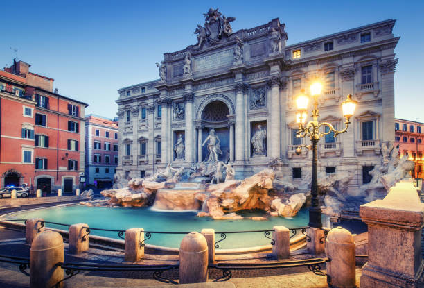 Trevi Fountain in Rome, Italy at sunrise. Scenic travel background. Trevi Fountain in Rome, Italy at sunrise. Scenic travel background. rome italy stock pictures, royalty-free photos & images