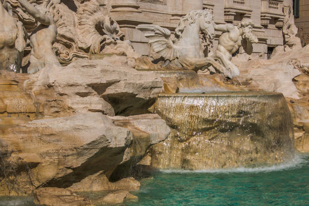 trevi fountain is the largest baroque in the city and one of the most famous in the world located in rome, italy - rome road central view foto e immagini stock