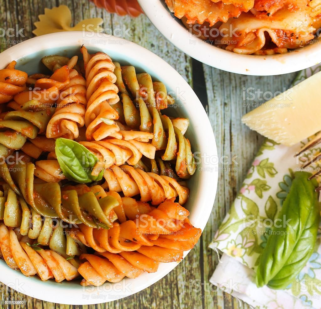 Tri color rotini Pasta with marinara sauce stock photo