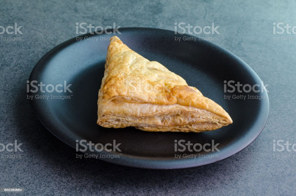 Triangle baked bread on plate on stone background stock photo