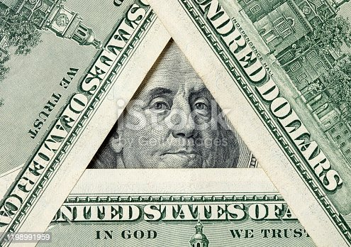 istock Triangle made of $100 bills with Benjamin Franklin inside 1198991959