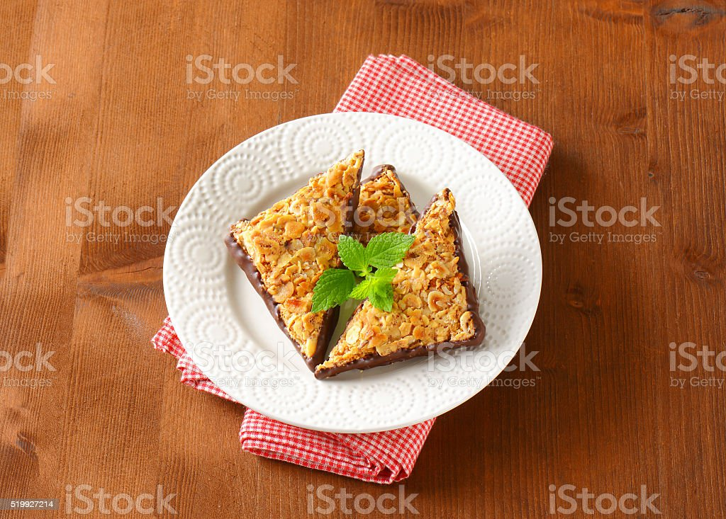 Triangle nutbars dipped in chocolate stock photo