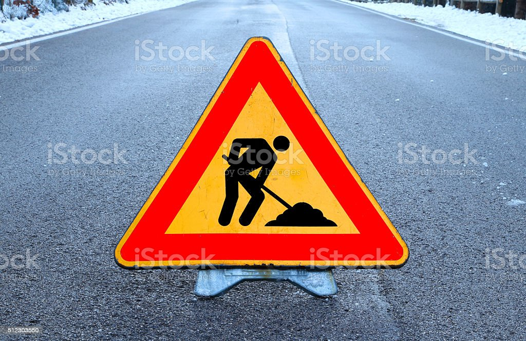 triangle road sign work in progress in the road stock photo