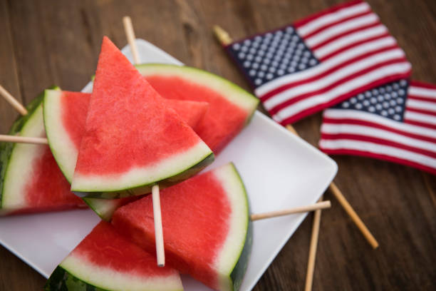 Triangle shaped watermelon on sticks for beach time fun stock photo