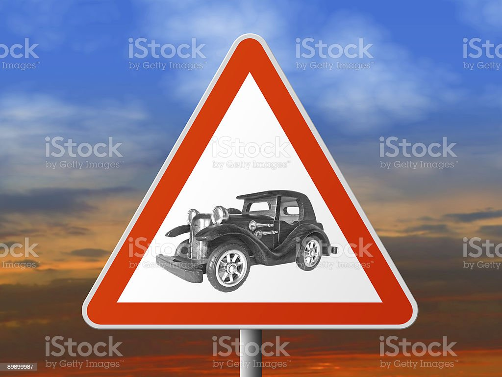 Triangle sign with vintage car royalty-free stock photo