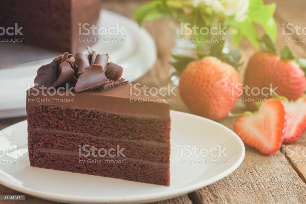 Triangle Slices Of Delicious Dark Chocolate Fudge Cake Decorated