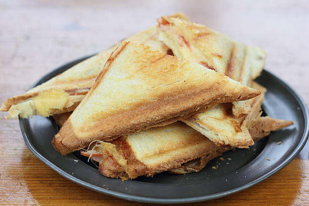 Triangle toasted sandwiches. stock photo