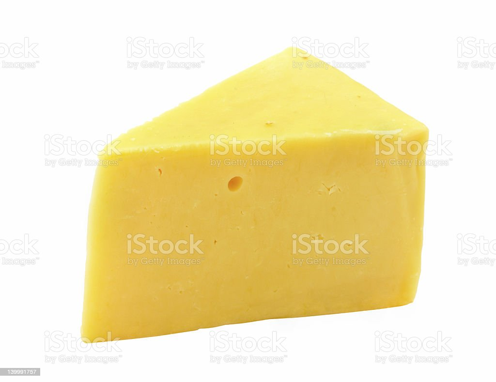 Triangular chunk of yellow cheese with holes royalty-free stock photo