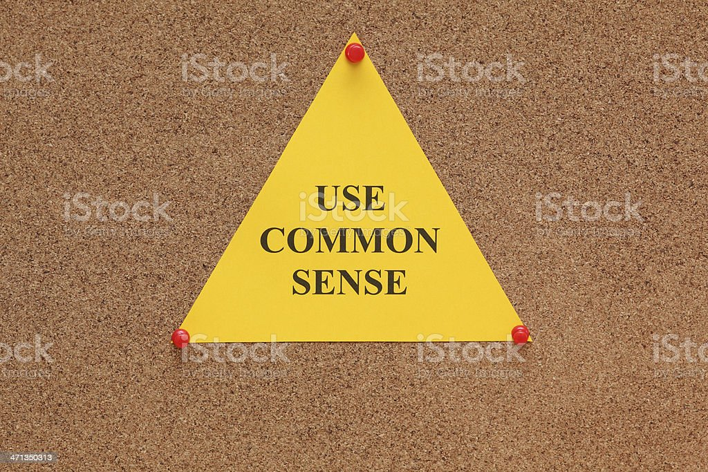 Triangular paper note with the words 'use common sense' royalty-free stock photo