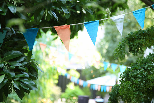 triangular pennant - garden party stock photos and pictures
