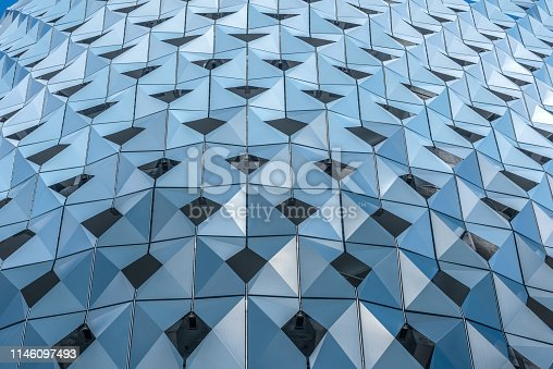 Abstract background with a triangular pattern of bluish. Coating on the wall of a public parking lot to provide shade and the passage of the breeze.