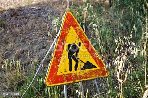 Triangular traffic sign which indicates work in progress on the road (Pesaro, Italy, Europe)