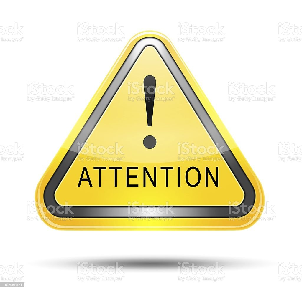 A triangular yellow sign that says attention  stock photo