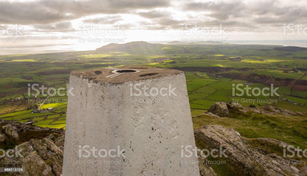 Triangulation survey pillar on the coast overlooking the sea stock photo