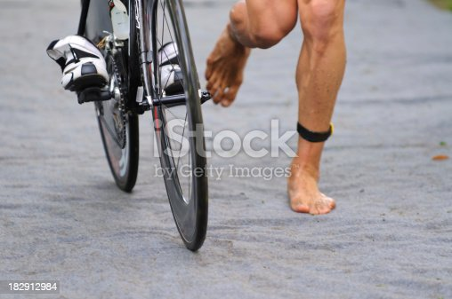 986840244 istock photo Triathlete in transition zone with timechip 182912984