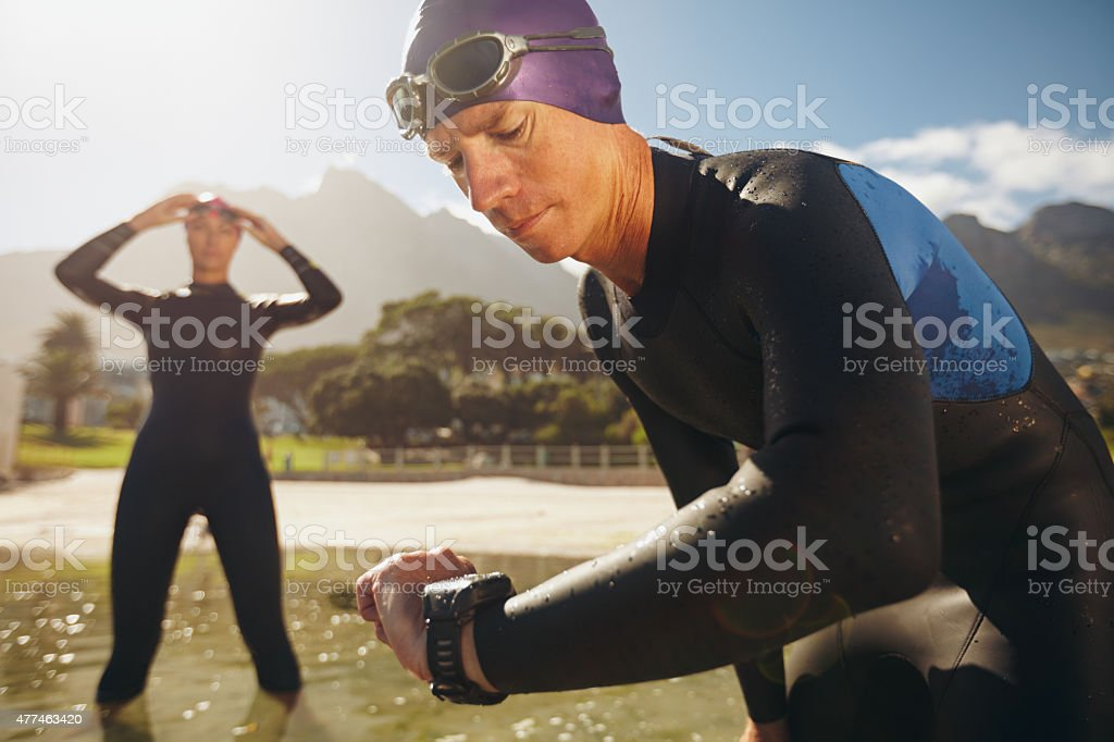 Triathletes practicing for race stock photo