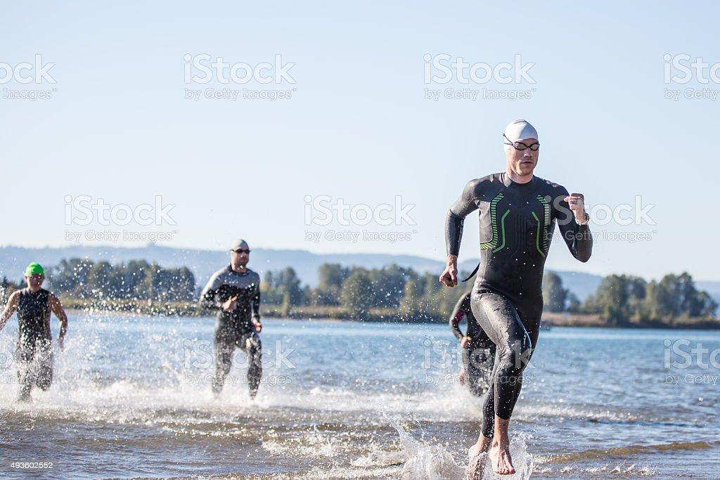 Triathletes training for a triathlon stock photo
