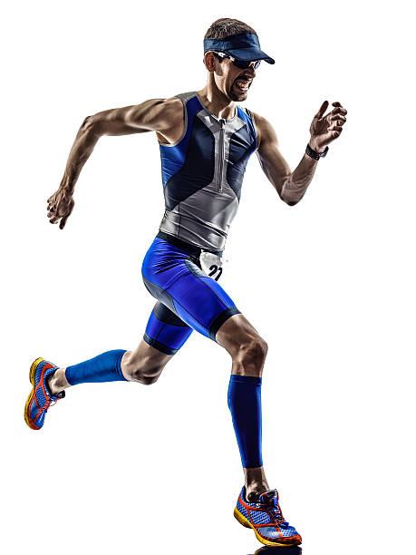 Triatlón hombre corriendo atleta corredores de hierro - foto de stock