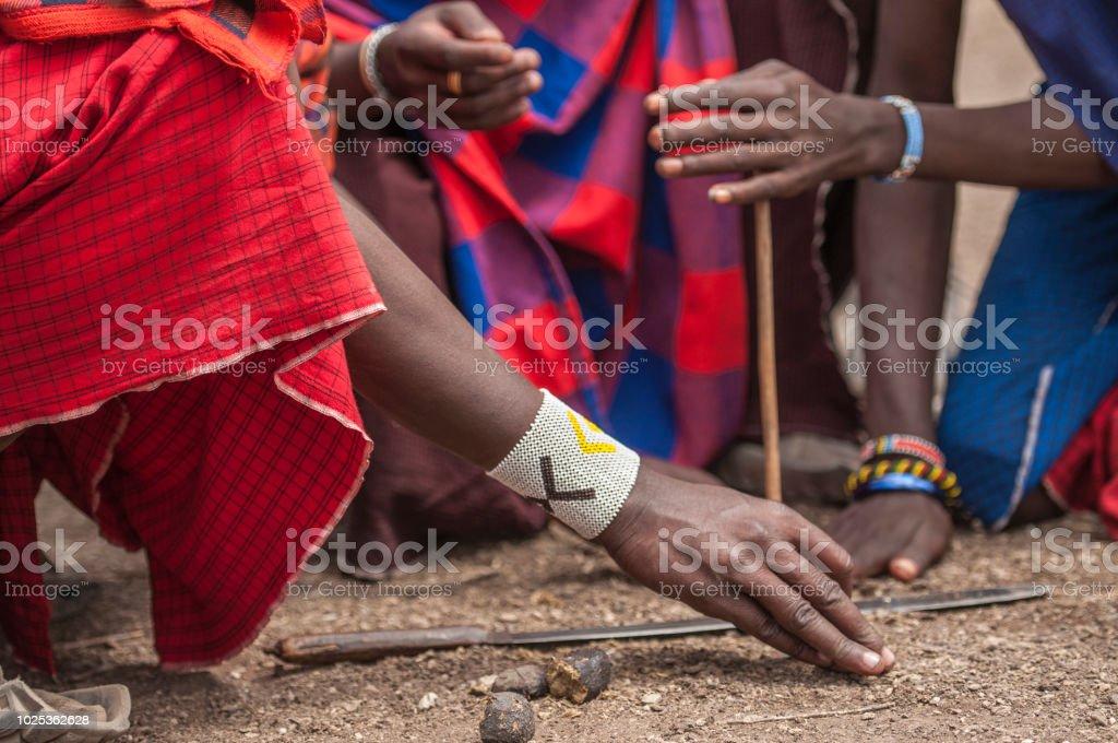 Traditional tribal bead work worn around wrist by Masai man as he...